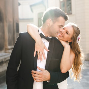Cheerful newlyweds sunlight street