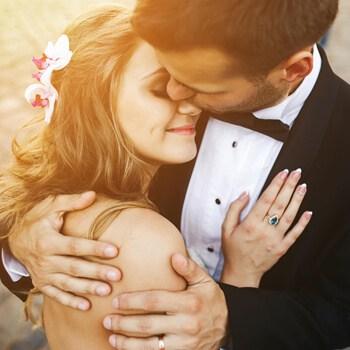 Smiling bride embracing her husband
